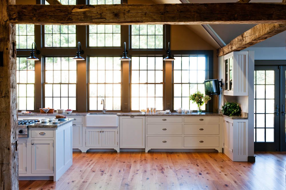 Traditional Kitchen featuring contrasting wood beams and white panel cabinets