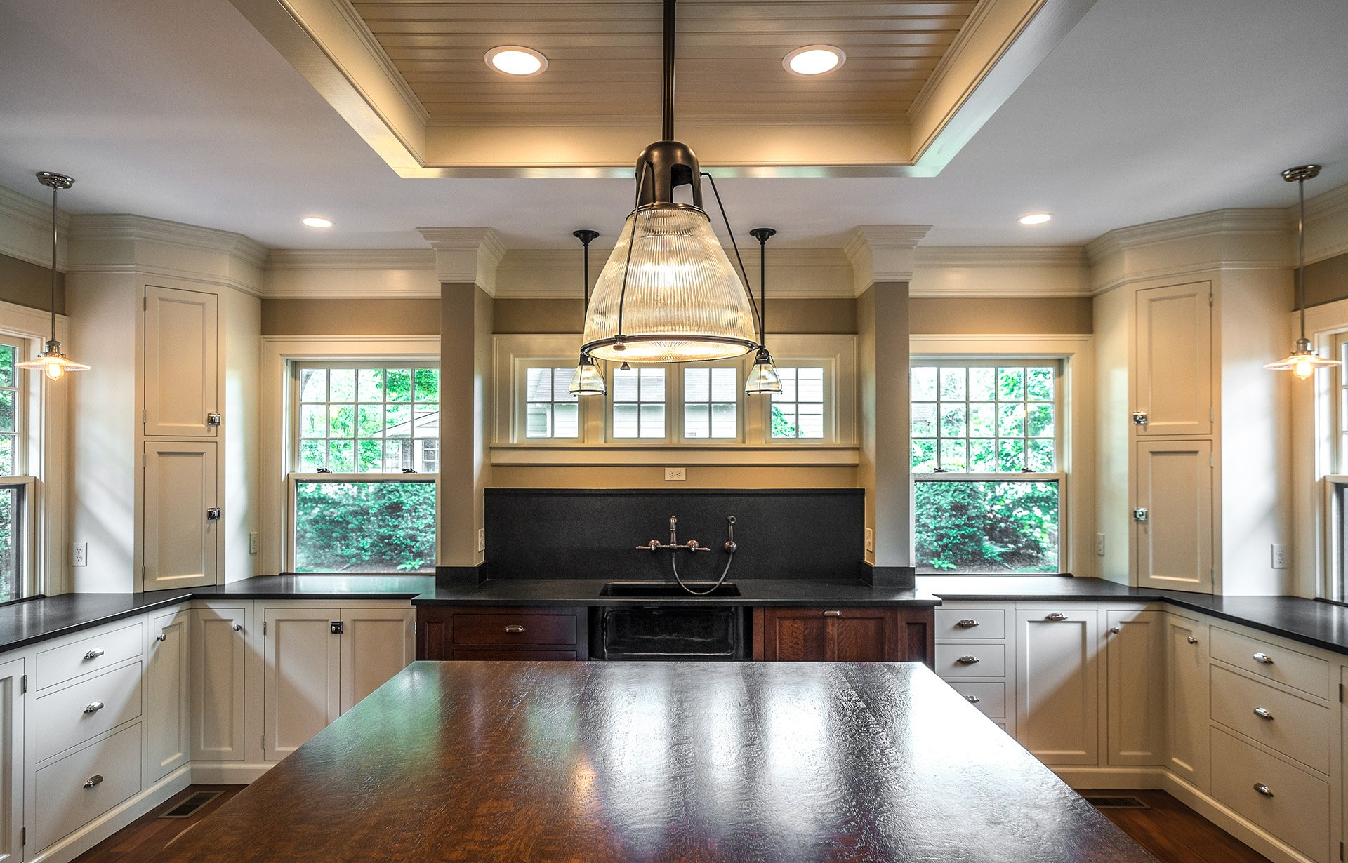 Kennebec Company designed this Transitional kitchen featuring open spaces and warm, neutral tones.