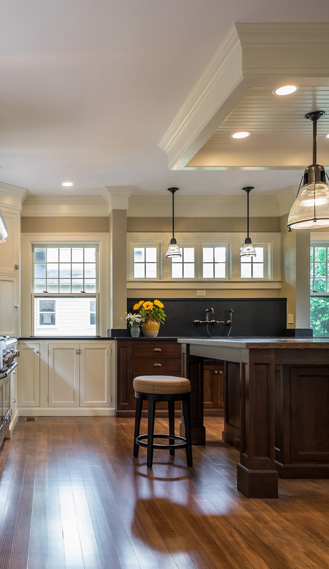 Transitional Kitchen featuring contrasting woods and white panel cabinets