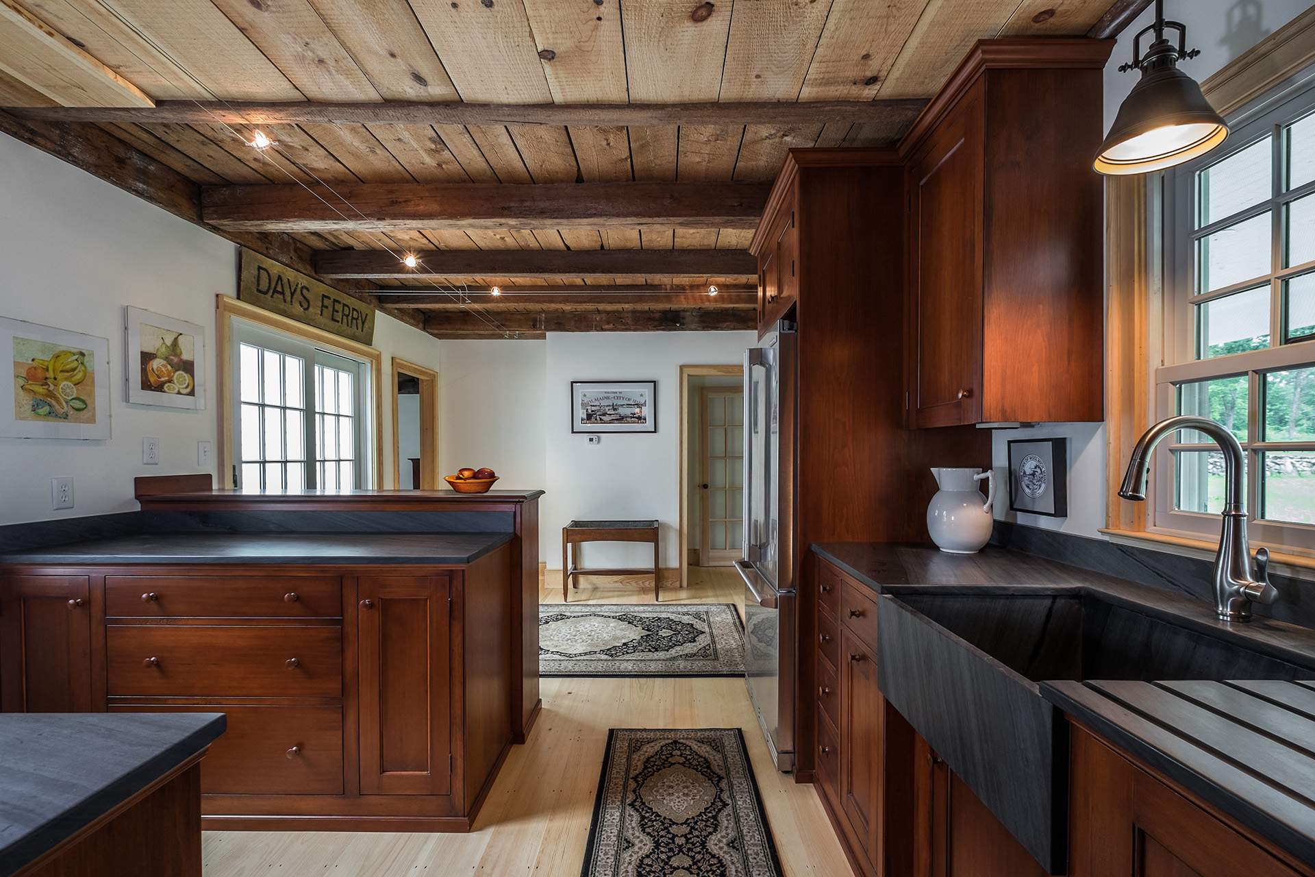 Farmhouse Kitchen featuring wood beams and dark wood cabinets